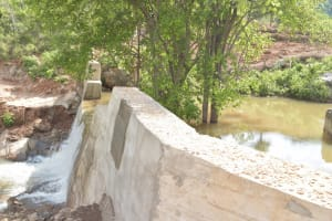 The Water Project: Kasioni Community B -  Water Rushes Over Sand Dam