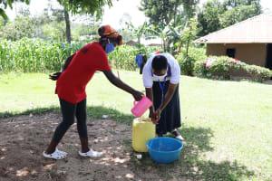 The Water Project: Shitungu Community, Omar Rashid Spring -  A Community Member Assisting The Facilitator