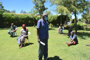 The Water Project: Musutsu Community, Mwashi Spring -  A Community Leader Addressing The Group