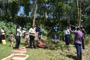 The Water Project: Lwenya Community, Warosi Spring -  Use Of Handouts At The Sensitization Training
