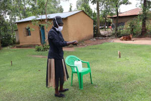 The Water Project: Shitungu Community, Hessein Spring -  Ms Shigali At The Training With Protective Gear