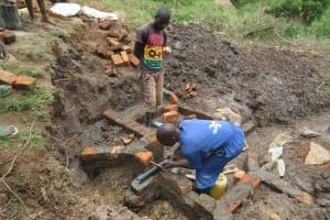 The Water Project: Mahira Community, Jairus Mwera Spring -  Pipe Setting