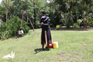 The Water Project: Masera Community, Ernest Mumbo Spring -  Handwashing Demonstration By Facilitator