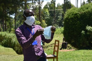 The Water Project: Musutsu Community, Mwashi Spring -  The Facilitator Demonstrating How To Make A Mask