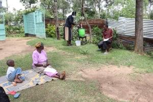 The Water Project: Masera Community, Salim Hassan Spring -  The Facilitator Leading Handwashing