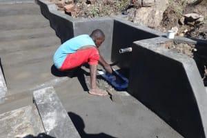 The Water Project: Mahira Community, Kusimba Spring -  Tile Setting