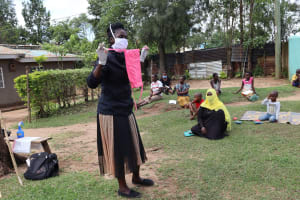 The Water Project: Masera Community, Salim Hassan Spring -  Ms Shigali Demonstrating How To Make Masks