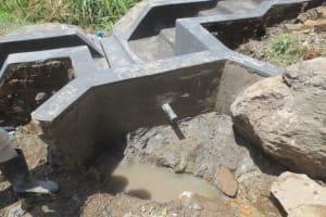 The Water Project: Mahira Community, Kusimba Spring -  Backfilling Clay Works