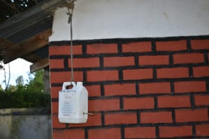 The Water Project: Lwenya Community, Warosi Spring -  A Leaky Tin As A Handwashing Station