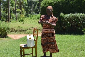 The Water Project: Musutsu Community, Mwashi Spring -  A Community Member Showing The Group How She Does Her Handwashing