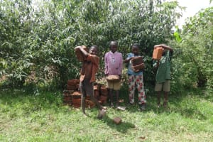 The Water Project: Mahira Community, Jairus Mwera Spring -  Kids Help Carry Bricks To The Spring