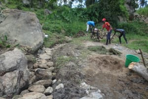 The Water Project: Mahira Community, Kusimba Spring -  Backfilling With Stones