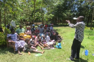 The Water Project: Mahira Community, Jairus Mwera Spring -  Community Leader Thanks Participants For Attending