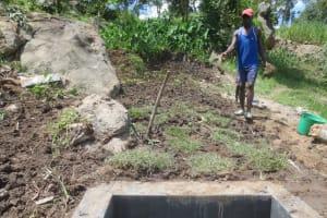 The Water Project: Mahira Community, Kusimba Spring -  Grass Planting