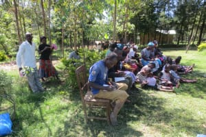 The Water Project: Mahira Community, Jairus Mwera Spring -  Participants Taking Notes