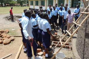 The Water Project: Friends School Vashele Secondary -  Facilitator Jonathan Shows Participarts Parts Of The Tank