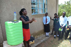 The Water Project: Ebubole UPC Secondary School -  Handwashing Demonstration With Trainer Lynnah