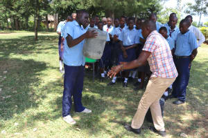 The Water Project: Friends School Vashele Secondary -  Trainer Jonathan Shows How To Use Leaky Tin