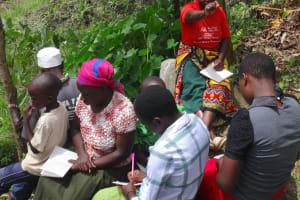 The Water Project: Mahira Community, Kusimba Spring -  A Community Member Addressing The Training