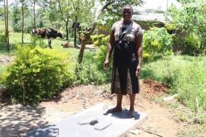 The Water Project: Mahira Community, Jairus Mwera Spring -  Posing On A Completed Sanplat