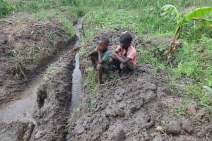 The Water Project: Mahira Community, Jairus Mwera Spring -  Extended Drainage Channels
