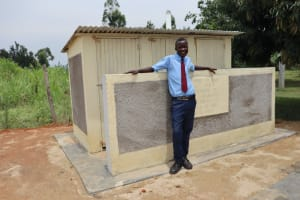 The Water Project: Friends School Vashele Secondary -  Student At Finished Latrine