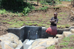 The Water Project: Mahira Community, Jairus Mwera Spring -  A Girl Poses By The Newly Completed Spring