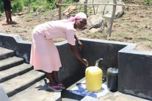 The Water Project: Mahira Community, Kusimba Spring -  Fetching Water