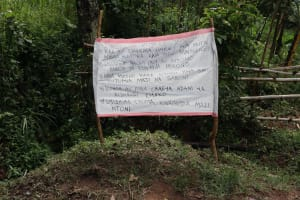 The Water Project: Shitungu Community, Hessein Spring -  Installed Chart At The Spring