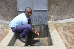 The Water Project: Friends School Vashele Secondary -  Moses Smiles At The Tank