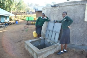 The Water Project: Ebubole UPC Secondary School -  Posing At The Rain Tank