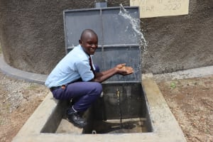 The Water Project: Friends School Vashele Secondary -  Moses Celebrates Clean Water
