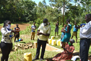The Water Project: Lwenya Community, Warosi Spring -  Trainer Alulu Leading The Handwashing Exercise