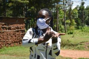 The Water Project: Musutsu Community, Mwashi Spring -  Miss Alulu Demonstrating Handwashing