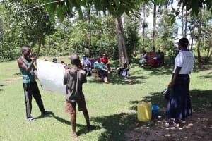 The Water Project: Shitungu Community, Omar Rashid Spring -  The Facilitator Using The Chart To Teach