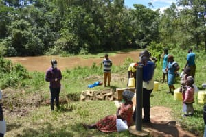 The Water Project: Lwenya Community, Warosi Spring -  Sir Erick Leading The Training