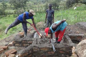 The Water Project: Mahira Community, Kusimba Spring -  Pipe Setting