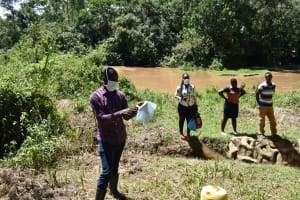 The Water Project: Lwenya Community, Warosi Spring -  The Facilitator Taught The Members How To Make A Mask