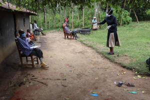 The Water Project: Masera Community, Ernest Mumbo Spring -  Madam Shigali Conducting Covid Sensitization
