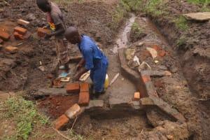 The Water Project: Mahira Community, Jairus Mwera Spring -  Wall Construction