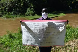 The Water Project: Lwenya Community, Warosi Spring -  The Facilitator Teaching With Help From The Chart