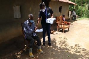 The Water Project: Masera Community, Ernest Mumbo Spring -  Facilitators Distributing Handouts To Facilitators