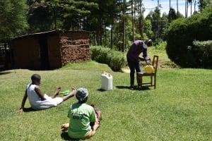 The Water Project: Musutsu Community, Mwashi Spring -  Sir Erick Making A Leaky Tin