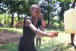 The Water Project: Shibuli Community, Khamala Spring -  A Girl Demonstrating Her Handwashing Skills