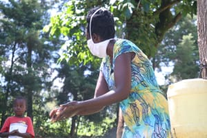 The Water Project: Shibuli Community, Khamala Spring -  Mrs Wagaka Demonstrating The Ten Steps Of Handwashing