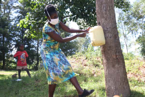 The Water Project: Shibuli Community, Khamala Spring -  Demonstrating How To Make A Leaky Tin
