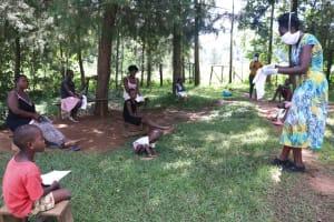 The Water Project: Shibuli Community, Khamala Spring -  Showing How To Make A Mask