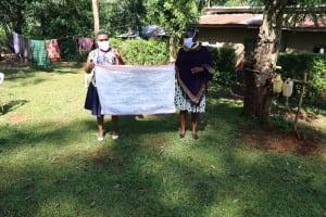 The Water Project: Shilakaya Community, Shanamwevo Spring -  A Sack With Written Covid Cautions