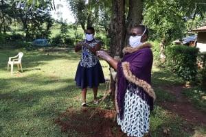 The Water Project: Shilakaya Community, Shanamwevo Spring -  Demonstrating Ten Handwashing Steps