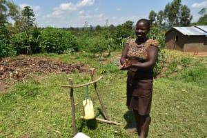 The Water Project: Musango Community, Jared Lukoko Spring -  A Community Health Volunteer Illustrates Steps Of Handwashing